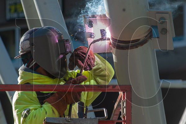 An ironworker with Local 29 and Carr Construction welds a section of roof truss. (Josh Kulla/DJC)