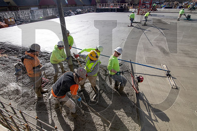 Finishers and laborers with LaRusso Concrete and Bremik Construction pour a first-floor slab at Beacon Lake Oswego. (Sam Tenney/DJC)