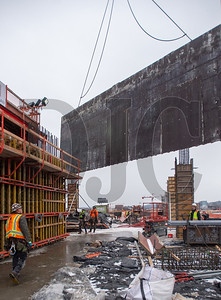 Carpenters from Hoffman Structures Inc. guide a wall of steel formwork into place for the core of 5 MLK. (Josh Kulla/DJC)