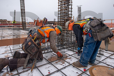 Carpenters Joe Griffith, left, and Dao Dang, both journeymen with Local 1503 and employees of Hoffman Structures Inc., take measurements for edgework at 5 MLK. (Josh Kulla/DJC)