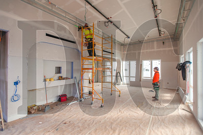 Carpenters with Westside Drywall construct a soffit in the sixth-floor community room. (Josh Kulla/DJC)