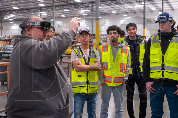 Rosendin Electric BIM modeler Brandon Penney demonstrates the use of augmented reality goggles during a School to Career event for high school students at the firm's Hillsboro shop and office. (Josh Kulla/DJC)