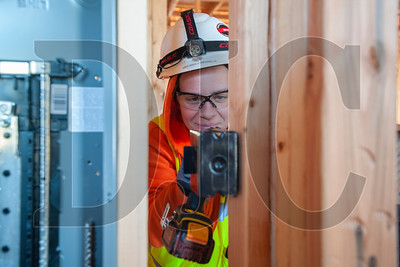 Melissa Cabanilla, a journeyman electrician with IBEW Local 48 and an employee of O'Neill Electric, roughs in a light switch receptacle box. (Josh Kulla/DJC)