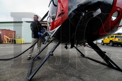 Brian Oliver, a line serviceman for Aurora Aviation, refuels a helicopter on Friday at Aurora State Airport.