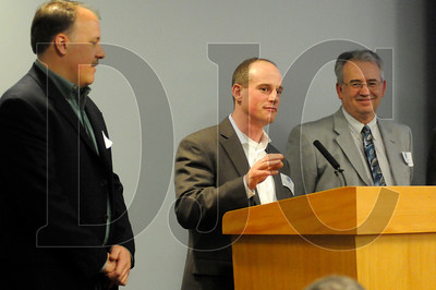 Mark Bodyfelt, left, a project manager with Stacy and Witbeck, listens as Eric Meisgeier, a project engineer with the company, speaks while accepting the Union Contractor of the Year on behalf of Stacy and Witbeck during the OBC Awards Banquet in Portland on Tuesday.  Also pictured, at far right, is Neil O'Connor, president of the OBC Board of Directors.