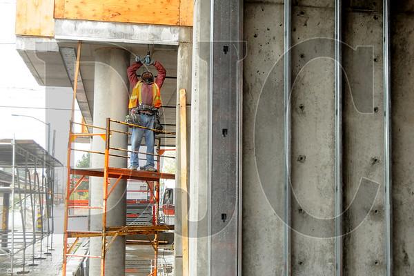 Lazar Bodunov, a steel stud framer with Union Construction LLC, works at the site of the Killingsworth Station development in Northeast Portland on April 15.