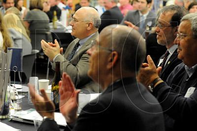 Audience members applaud as Jay Etnier (not pictured) takes the stage to accept the Pete Anderson Technical Educator of the Year award during the OBC Awards Banquet in Portland on Tuesday.