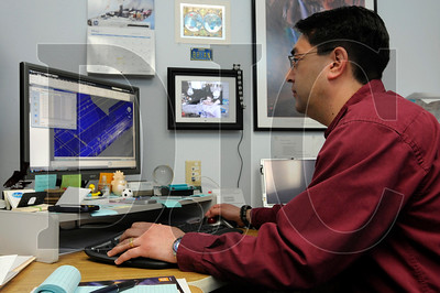 Brian Miyake, a production manager with i-TEN Associates, works in the company's Southeast Portland office on Monday.  Small firms like i-TEN and its partner company, ValueCad, stand to benefit from a state senate bill requiring public agencies to compensate firms for bidding work on indefinite quantity contracts.