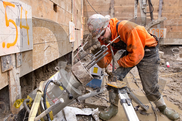 Charles Pacheco, a journeyman operating engineer with Local 701 and employee of DeWitt Construction, sets up a dial indicator before load testing a tieback.