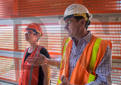 Justin Paterson, right, a Hoffman Construction project manager, speaks about his firm's role in the Multnomah County Courthouse project, as Benson Polytechnic High School career counselor Peggy Schoettle listens, during the annual Industry for a Day event. (Josh Kulla/DJC)