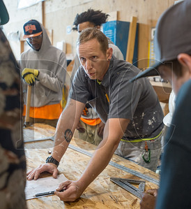 Portland Opportunities Industrialization Center instructor Torre Sathrum, a former general contractor, leads pre-apprentice students through a lesson in laminates at the Northwest College of Construction. (Josh Kulla/DJC)
