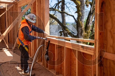 Julio Cesar, a carpenter with Wood Mechanix, frames a second-story window opening. (Josh Kulla/DJC)