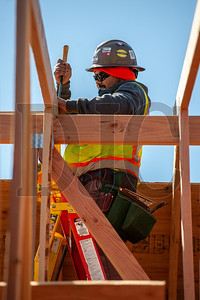 Journeyman carpenter Gabriel Abarca, an employee of Wood Mechanix, installs a roof truss. (Josh Kulla/DJC)