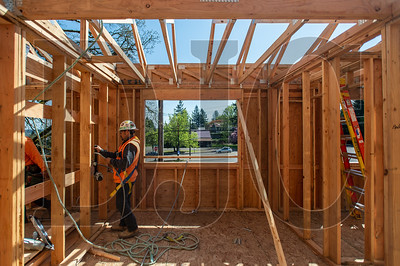 Wood Mechanix carpenter Julio Cesar frames second-floor window opening. (Josh Kulla/DJC)