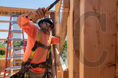 Adolfo Huerta, a carpenter with Timberland Inc., frames interior walls for Magnolia II, in Northeast Portland, using 3-D BIM modeling and prefabricated wall panels. (Josh Kulla/DJC)