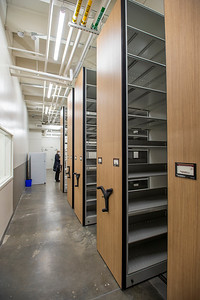A long-term evidence storage area contains space-saving rolling shelving units. (Josh Kulla/DJC)