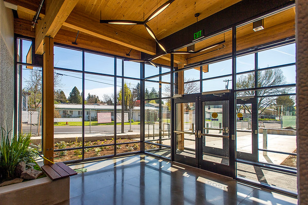 Floor-to-ceiling glazing provides ample daylight in a public entry to the civic center portion of the building.  (Josh Kulla/DJC)