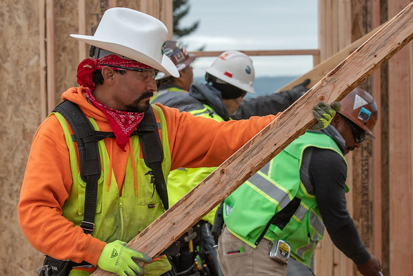 Juan Ledesma, a journeyman carpenter with Wood Mechanix, holds a support as colleagues secure a wall panel at the Halsey 106 affordable housing project in the Gateway area. (Josh Kulla/DJC)
