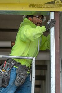Journeyman carpenter Mario Marisal of B&I Construction frames a ground-floor storefront section. (Josh Kulla/DJC)