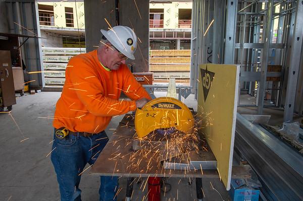 Tom Zutela, a journeyman carpenter and crew foreman with B&I Construction, cuts a metal stud. (Josh Kulla/DJC)