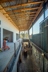 The main corridor connecting the entrance with the two large wings of the building features a vaulted ceiling. (Josh Kulla/DJC)