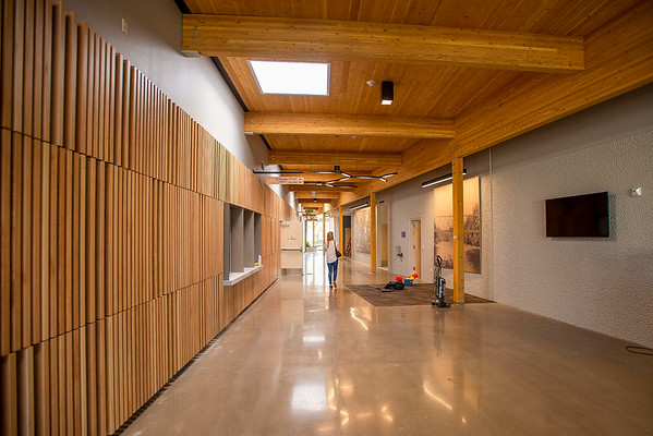 A gently tapering public corridor topped with cross-laminated timber panels separates city hall from the police department at the new Gladstone Civic Center. (Josh Kulla/DJC)