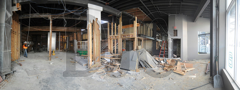 A panoramic image consisting of five separate photographs showing the interior of the former Aura nightclub, currently undergoing selective demolition.