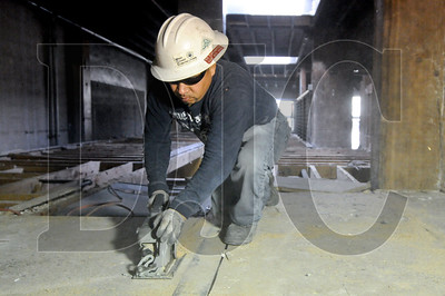 Rudy Roa, a laborer with Performance Abatement Services and member of Local 296, removes floors from a mezzanine at the former Aura nightclub on West Burnside Street in Portland Friday. General contractor Lease Crutcher Lewis is two weeks into a 4.5 month renovation of the building and an adjacent property on Southwest Stark Street.