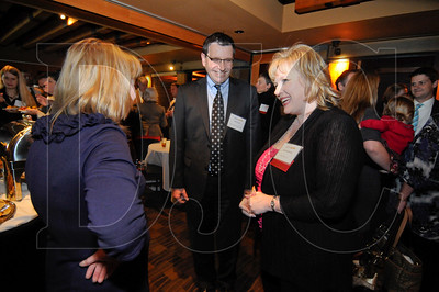 The Daily Journal of Commerce honored attorneys selected as Up & Coming Lawyers, as well as the DJC's Unsung Legal Heroes, with a reception sponsored by Barran Liebman Wednesday evening at the Portland City Grill. Peter O. Watts of Jordan Ramis PC, pictured with DJC publisher Rynni Henderson, was selected as DJC 2012 Up & Coming Lawyer of the Year. Oregon State Law Librarian Cathryn E. Bowie was selected as the 2012 Unsung Legal Hero of the Year.