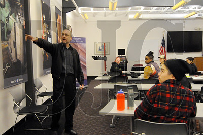 Kevin Roth, training director with the Sheet Metal Institute, points to a banner while discussing the various types of work that sheet metal workers do.