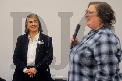 Connie Ashbrook, executive director of Oregon Tradeswomen, listens as program alumni and joureyman sheet metal worker Allie Medeiros speaks about her history in the trade.