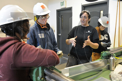 Lisa Davis, third from left, speaks to Oregon Tradeswomen students about her transition from being a medical student at Oregon Health Sciences University to becoming a sheet metal worker. Davis will become a journeyman later this month.