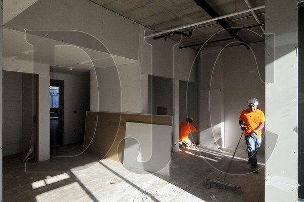Crews with Columbia Drywall Systems work in one of the building's live/work units.