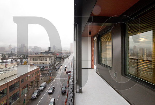 A sixth-floor balcony offers views of the Central Eastside and the downtown skyline.