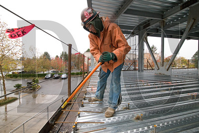 Jason Trickett, a journeyman carpenter with RDF Builders and member of Local 1503, uses a hickey bar to bend rebar.