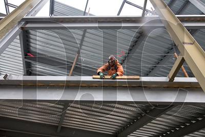Jason Trickett installs batter boards in preparation for a second-floor concrete deck pour.