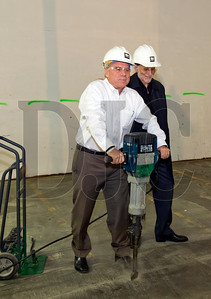 R&H Construction President John Ward, left, operates a jackhammer as Jim Winkler, president of Winkler Development Corp., looks on, during a groundbreaking for The Hopper last week in Northwest Portland. Winkler Development Corp. is partnering with Watamull Properties to convert the former printing plant space to a 167,000-square-foot urban industrial campus. R&H Construction will perfom core and shell improvements, and will also be leasing 19,000 square feet of office space and 34,000 square feet of industrial space, which the firm will use as a shop and field resource center. LRS Architects is designing both the core and shell renovations and R&H's office build-out. Improvements to the building will include a new roof and a full voluntary seismic upgrade. (Sam Tenney/DJC)