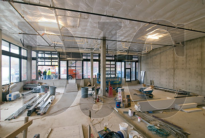 The building's commercial spaces feature 17-foot ceilings and roll-up doors.