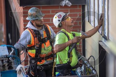 Platinum Exteriors carpenters install siding at Cornelius Place.
