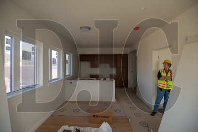 Cornelius Public Library Executive Director Karen Hill inspects a one-bedroom residential unit in Cornelius Place.
