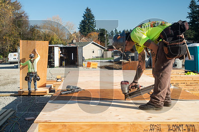 Carpenters Collin O'Connell, left, and David Ramirez, both employees of DSL Builders, frame walls for the new Ogden Elementary School.