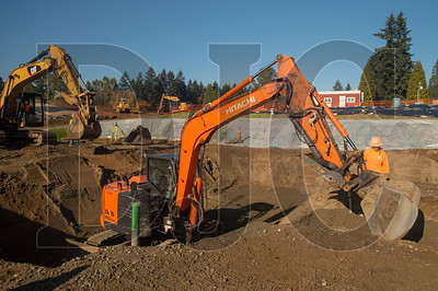 Excavation crews with Tapani Underground perform site work at the new iTech Preparatory Academy in Vancouver.