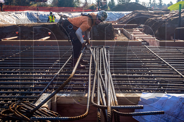 CJ Barton, a journeymen ironworker with Local 29 and an employee of SI Contracting, lays out rebar for foundation formwork at the iTech Preparatory Academy site.