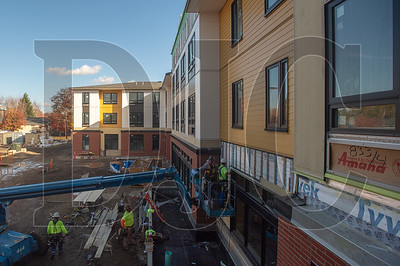 Platinum Exteriors' siding crews work in the courtyard of the new Cornelius Place mixed-use project.