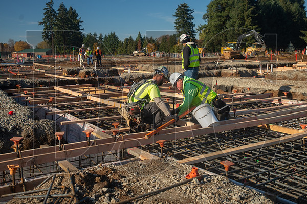 Carpenters with Skanska USA Building construct formwork for the new Marshall Elementary School in Vancouver.