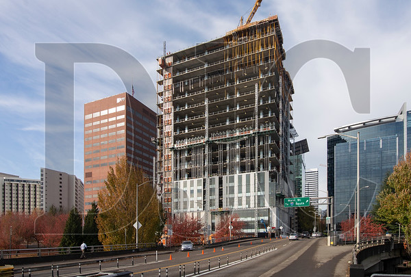 The 17-story is being erected at the west end of the Hawthorne Bridge.