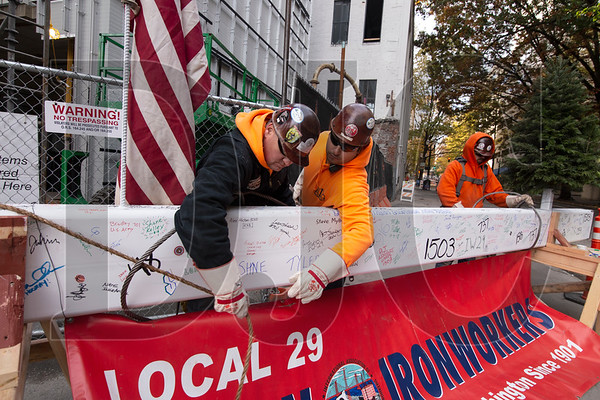 Union ironworkers with Alliance Industrial Group prepare the beam to be hoisted atop the structure.