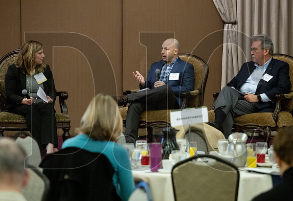 Stephanie Holmberg, left, moderates a discussion with Dr. Michael Wilkerson, center, and Mike Salsgiver during the DJC's Builder Breakfast event at the Sentinel Hotel in downtown Portland. (Sam Tenney/DJC)