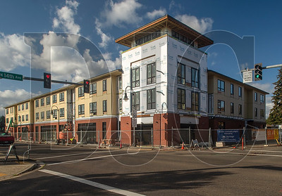 The Cornelius Place mixed-use building will feature 45 affordable senior housing units and the new Cornelius Public Library.