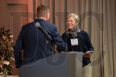Lisa Pickert, safety coordinator with Neil Kelly Company, greets DJC publisher Nick Bjork while accepting the firm's award. (Sam Tenney/DJC)